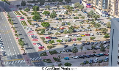 Top view of parking lot timelapse from rooftop of skyscraper