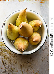 Top view of pears in bowl. Rustic vintage style