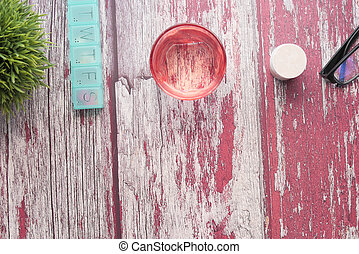 Top view of pill box, pill container and water glass on table