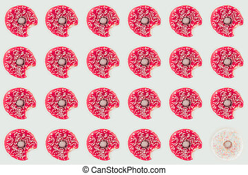 top view of pink glazed doughnuts seamless pattern isolated on white