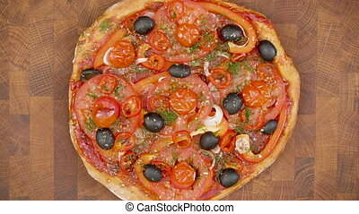 Top view of pizza with ingredients on the wooden table - stop motion animation