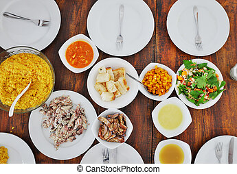 Top view of plates with different food on the table