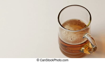 Top view of pouring beer into a glass