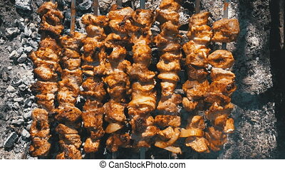 Top View of Preparing Shish Kebabs on Skewers over a Fire in Nature