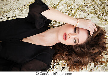 Top view of pretty sensual young woman in black dress