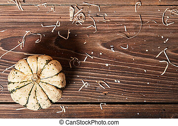 Top view of pumpkin on a wooden table