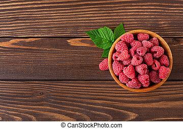 top view of raspberries in bowl