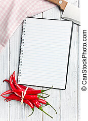 recipe book with chili peppers - top view of recipe book...
