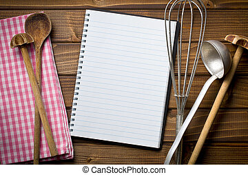 recipe book with kitchenware