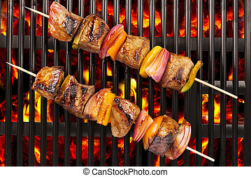 Top view of red meat skewers