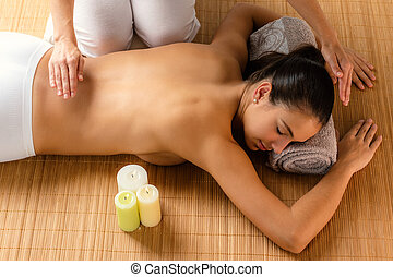 Top view of reiki therapist doing treatment on woman.