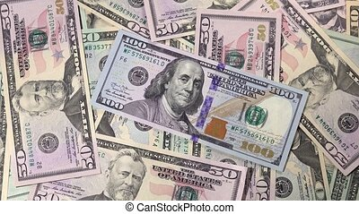Top view of rotating dollars banknotes of different value
