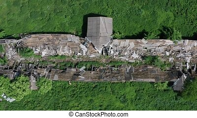 Top view of ruined cowshed - Drone shot of destroyed...