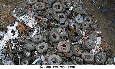 Top view of rusty tires lying in heap on disposal dump -...