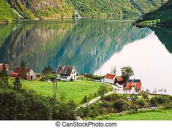 View Of Scandinavian Houses In Norwegian Village On Shore Of The