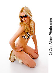 top view of sensuous model wearing sunglasses with white...