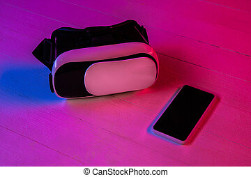 Top view of set of gadgets in purple neon light