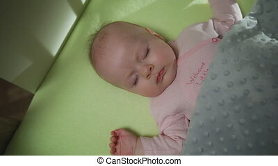 Top View of Sleeping newborn baby dolly shot