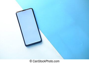 top view of smart phone on color background