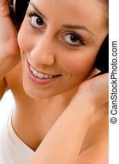 top view of smiling woman enjoying music