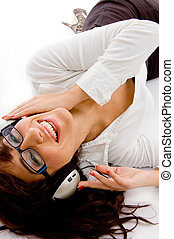 top view of smiling woman listening music