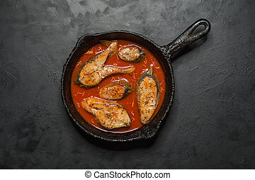 Top view of spicy and hot Bengali fish curry.