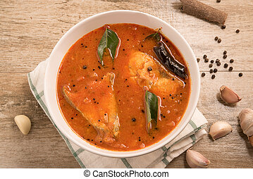 Top view of spicy and hot king fish curry with green curry leaf Kerala