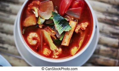 Top view of spicy prawns soup on a wooden table. 1920x1080,...