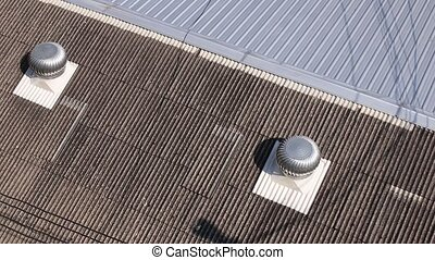 Top view of spinning turbine ventilators working on roof -...