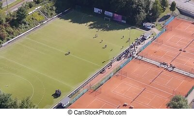 top view of sport fields with people moving around one