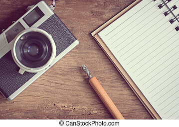 Top view of stationery and camera
