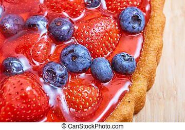 Top view of strawberry and blueberry cake with jelly