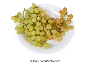 Top view of sultana grape cluster on white dish