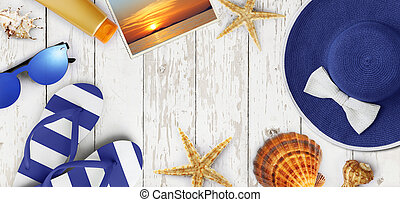 Top view of summer beach accessories on wooden white background, vacation and travel concept