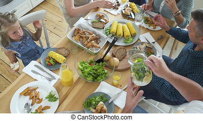 Top view of table with meals. family or friends having dinner at table with food