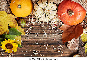 Top view of table with pumpkin and straw