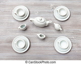 top view of tea set on gray brown table