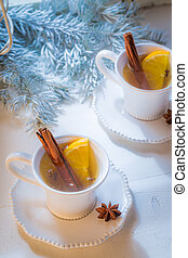 Top view of tea with cinnamon and orange for Christmas