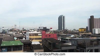 Top view of Thai temple roof in the city on blue sky Bangkok Thailand. White clouds in blue sky over Bangkok city , Thailand and express way top roof view timelapse