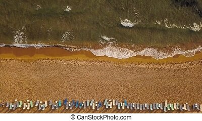 Top view of the beach and sun beds. The deserted coast of the Ionian Sea, Greece, Corfu