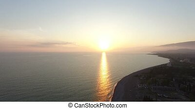 Top view of the beautiful sunset over the sea.
