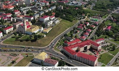 Top view of the city center of Grodno, Belarus. The historic center of the city with a red tile roof and an old Catholic Church