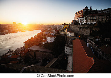Top view of the Douro river at sunset time in Porto, Portugal.