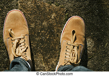 top view of the feet with adventure boots