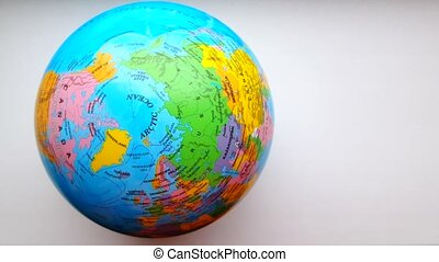 Top view of the globe rotation on a white background, 4k, video, framing and travel concept
