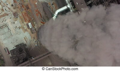 Top view of the metallurgical plant. Smoke coming out of factory pipes.