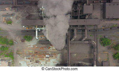 Top view of the metallurgical plant. Smoke coming out of...