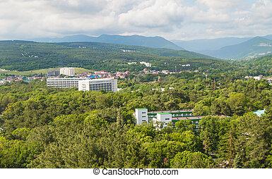 Top view of the panorama of the village of Divnomorskoye, near Gelendzhik on the Black Sea coast, sanatorium buildings and a park area.
