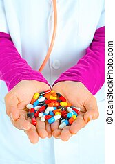 Top view of the pills on the hand and white background, A hand hold the pills and drug, Pile of the drug and pills on the hand.