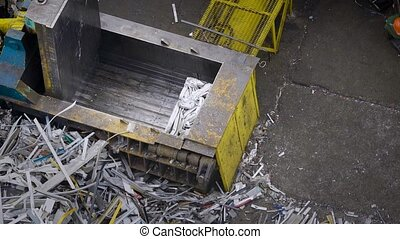 Top view of the process of pressing debris from various...